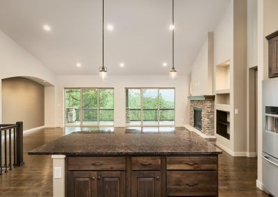 14) Woodland Cottage Interior Kitchen Island Great Room Stone Fire Place