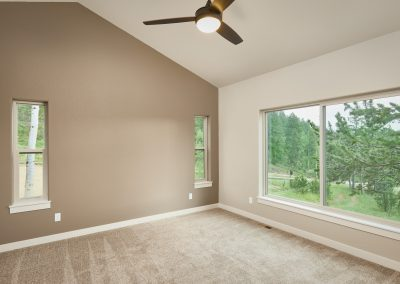 19) Woodland Cottage Master Bedroom Windows Fan